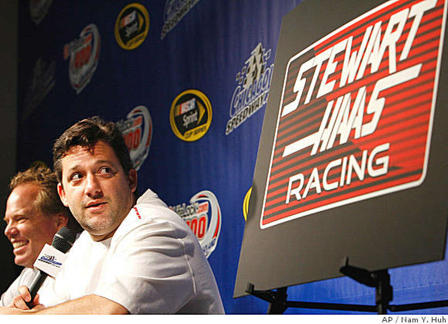 Tony Stewart, right, and Joe Custer, general manager of Haas-CNC Racing, attend a news conference at which they announced that Stewart will become a driver for and co-owner of the NASCAR auto racing team Thursday, July 10, 2008, at Chicagoland Speedway in Joliet, Ill. (AP Photo/Nam Y. Huh) Photo: Nam Y. Huh, AP