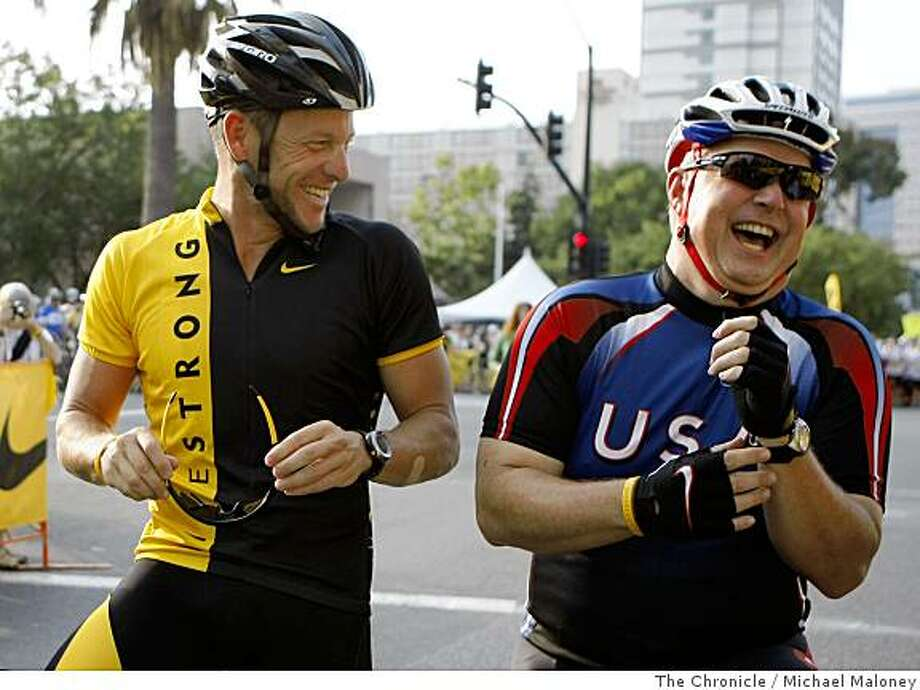 Lance Armstrong, left, shares a laugh with Shawn Petty, of Colorado Springs prior to their 100 mile ride. Nearly 3,000 cyclists, runners and walkers participated in the Lance Armstrong Foundation's Livestrong Challenge in San Jose, Calif., on July 13, 2008. The event, put on with the help of 650 volunteers, consisted of a 5K run/walk and 10 to 100 mile bike rides and raised over $15 million for cancer research.Photo by Michael Maloney / The Chronicle Photo: Michael Maloney, The Chronicle