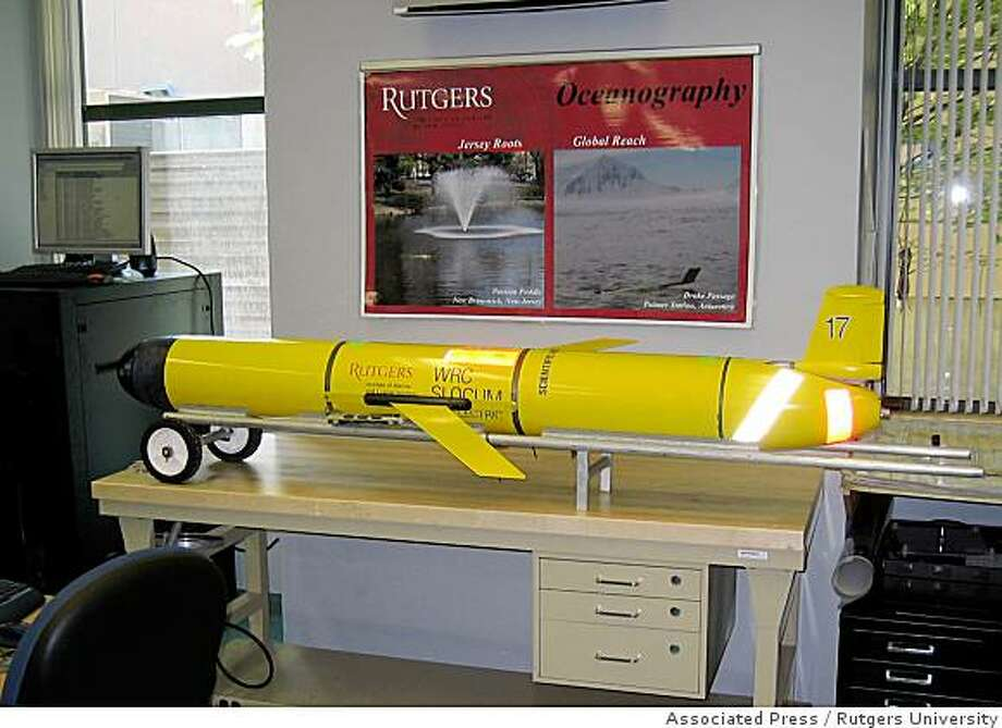 "This undated handout photo provided by Rutgers University shows a little yellow remote-controlled submarine at Rutgers University in New Jersey. ""The big advantage is, it's totally unmanned. It's very efficient and can be used to obtain the same kind of data we gather from ships,"" explained Conrad Lautenbacher, head of the National Oceanic and Atmospheric Administration, a sponsor of the glider developed and operated by Rutgers University. (AP Photo/Rutgers University) Photo: Rutgers University, Associated Press"