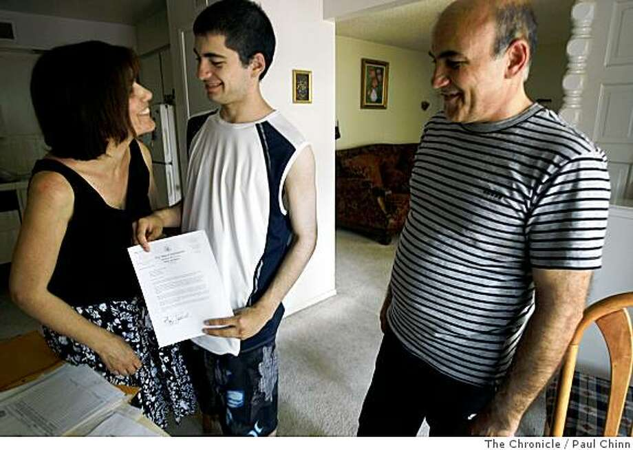 Asmik Karapetian, left, son Arthur, center, and husband Ruben Mkoian smile as they look at Sen. Dianne Feinstein's letter of support at their home in Fresno, Calif., on Thursday, June 26, 2008. The Armenian family immigrated to the United States about 16 years ago and may be deported by Immigrations and Customs Enforcement if a bill introduced Feinstein fails to pass.Photo by Paul Chinn / The Chronicle Photo: Paul Chinn, The Chronicle