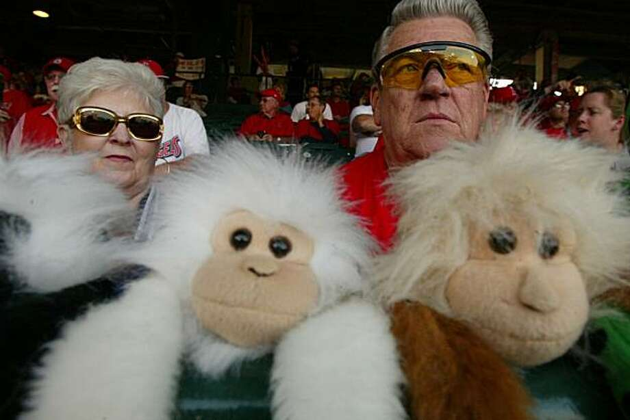 GIANTS11-C-20OCT02-MT-MK.jpg---Angels fans Rosemary and Larry Littleton, of Laverne, Ca., with their collection of rally monkeys. The San Francisco Giants play the Anaheim Angels in Game 2 of the World Series at Edison Field in Anaheim, Ca. October 20, 2002.   Mike Kepka/San Francisco Chronicle Photo: Mike Kepka, The Chronicle