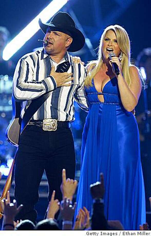 LAS VEGAS - MAY 18:  Music artist  Garth Brooks (L) and his wife, singer Trisha Yearwood, perform during the 43rd annual Academy of Country Music Awards at the MGM Grand Garden Arena May 18, 2008 in Las Vegas, Nevada.  (Photo by Ethan Miller/Getty Images) Photo: Ethan Miller, Getty Images