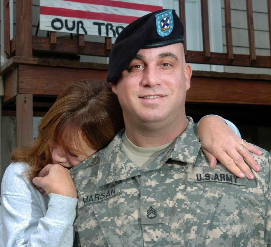 Staff Sgt. Nick Marson of the Connecticut Army National Guard gets a hug from his mother, Debbie, in front on their faimily home in Fairfield, Conn. on Nov. 6th, 2009. Marsan will deploy to Afghanistan with the 102nd Infintry later this month. Photo: Ned Gerard / Connecticut Post