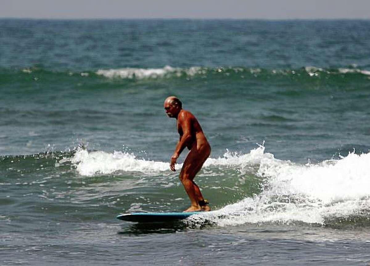 """""""Jimmy Jo"""" of Sun City, Calif., surfs at the Trail 6 portion of San Onofre State Beach. Illustrates CALIF-NUDEBEACH (category a) by Mike Anton (c) 2008, Los Angeles Times. Moved Thursday, July 10, 2008. (MUST CREDIT: Los Angeles Times photo by Allen J. Schaben.)"""