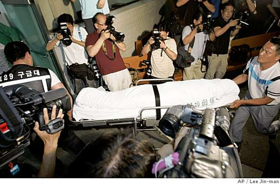 The body of a South Korean who was shot to death by a North Korean soldier at the Diamond Mountain resort in North Korea, arrives at National Institute of Scientific Investigation in Seoul, South Korea, Friday, July 11, 2008. A North Korean soldier fatally shot a South Korean tourist Friday at a mountain resort in the communist nation, raising tensions and prompting the South to suspend the high-profile tourism program just as its new president sought to rekindle strained ties between the divided countries. (AP Photo/ Lee Jin-man) Photo: Lee Jin-man, AP