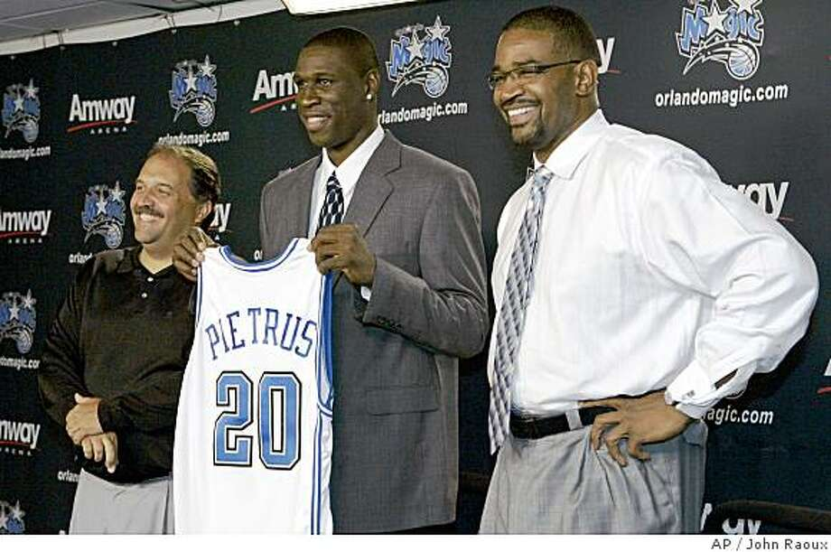 Orlando Magic head coach Stan Van Gundy, left, and General Manager Otis Smith, right, introduce guard-forward Mickael Pietrus, of France,  at a news conference after he signed a contract with the Orlando Magic in Orlando, Fla., Thursday, July 10, 2008. (AP Photo/John Raoux) Photo: John Raoux, AP
