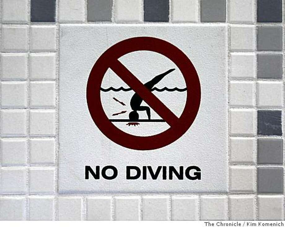 A tile cautions swimmers not to dive as Coffman Pool at the corner of Visitacion and Hahn streets in San Francisco, Calif., reopens on Friday, July 11, 2008 after a lengthy $10 million renovation.Photo by Kim Komenich / The Chronicle Photo: Kim Komenich, The Chronicle