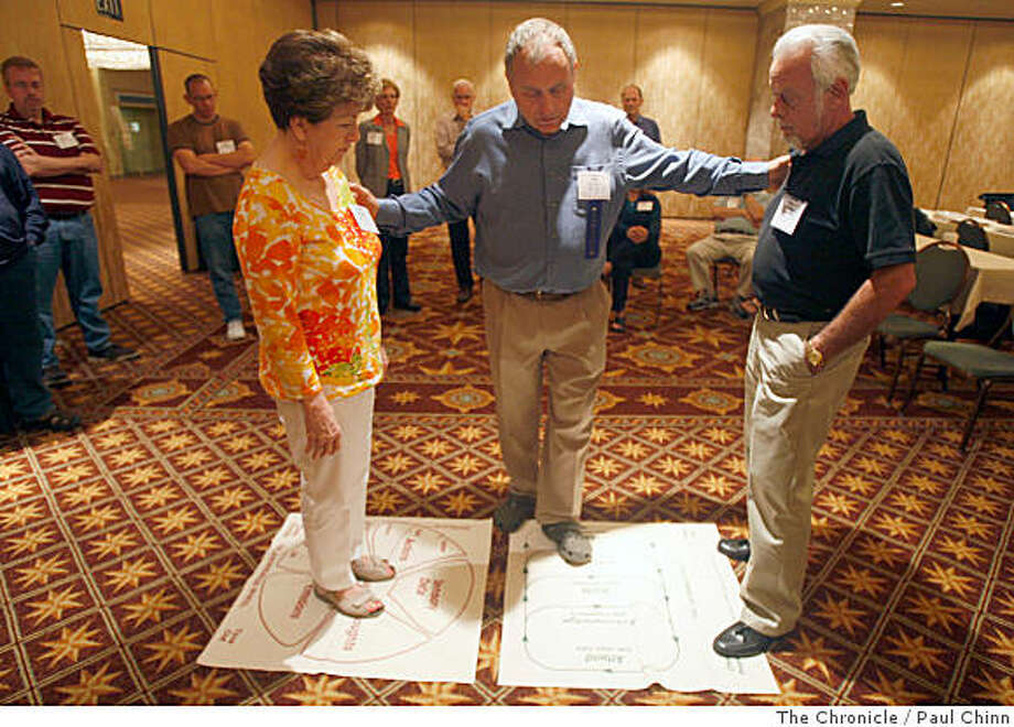 Discussion leader Sherod Miller, center, guides Audrey Hubbard, left, and her husband Dee Jay through an exercise in the Couple Communication workshop at the Smart Marriage conference in San Francisco, Calif., on Wednesday, July 2, 2008.Photo by Paul Chinn / The Chronicle Photo: Paul Chinn, The Chronicle