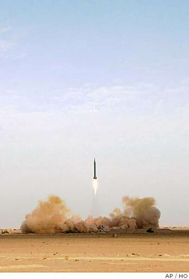 In this image made available Thursday July 10, 2008, from Sepah News website owned by Iran's Revolutionary Guards, showing Iran's Shahab-3 missile being launched from an undisclosed location on Wednesday July 9, 2008, which officials have said has a range of 1,250 miles and is armed with a 1-ton conventional warhead. Iran test-fired long-and medium-range missiles during the day, Wednesday, that officials say is in response to U.S. and Israeli threats, state television reported. (AP Photo/Sepah News) ** EDITORIAL USE ONLY ** Photo: HO, AP