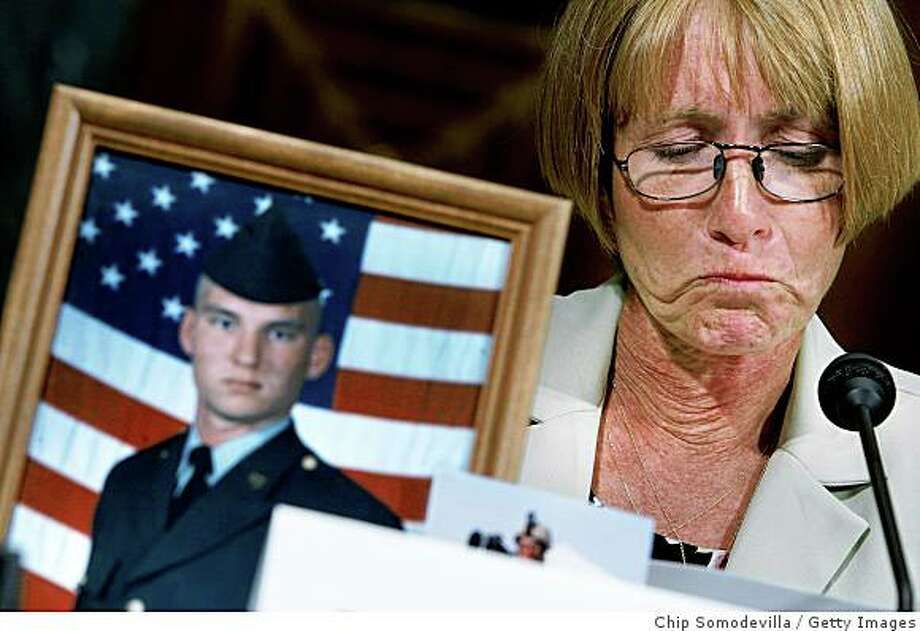 WASHINGTON - JULY 11:  Larraine McGee of Huntsville, Texas, fights back tears while talking about how her son, Staff Sgt. Christopher Everett, was killed by electrocution while serving in Iraq July 11, 2008 in Washington, DC. McGee was testifying before the Senate Democratic Policy Committee during a hearing about the electrocution deaths of 10 army soldiers, one Marine and two U.S. contractors in Iraq and Afghanistan.  (Photo by Chip Somodevilla/Getty Images) Photo: Chip Somodevilla, Getty Images