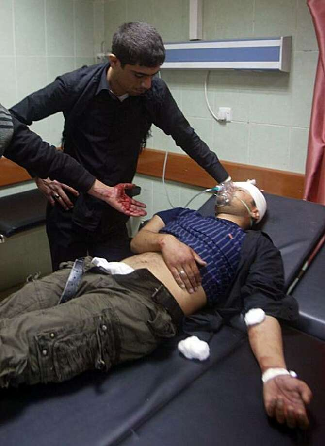 An Iraqi man lies injured in the emergency room of a hospital in Tuz Kurmatu, 175kms north of Baghdad, on December 27, 2009. Police said that a bomb ripped through a procession marking Ashura in the northern town of Tuz Khurmatu, near oil-rich Kirkuk, killing four people and wounding 19. AFP PHOTO / MARWAN IBRAHIM (Photo credit should read MARWAN IBRAHIM/AFP/Getty Images) Photo: Marwan Ibrahim, AFP/Getty Images
