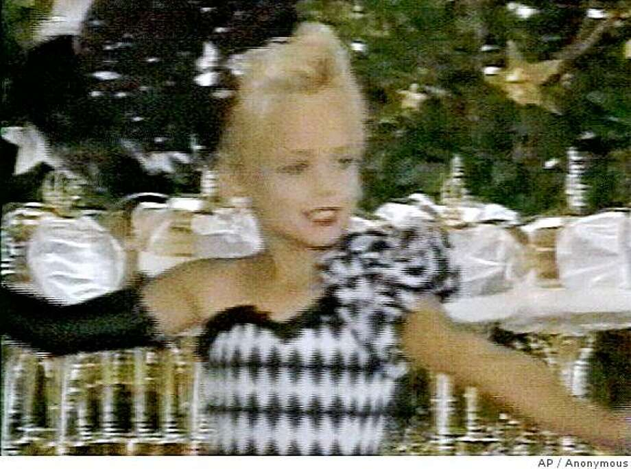 **FILE**This file image made from an undated family video shows JonBenet Ramsey performing during a beauty pageant. Citing new DNA tests, prosecutors on Wednesday, July 8, 2008, cleared JonBenet Ramsey's parents and brother in the 1996 killing of the 6-year-old beauty queen and apologized to the family for casting the cloud of suspicion that hung over them for more than a decade. (AP Photo/Ramsey family video) **NO SALES** Photo: Anonymous, AP