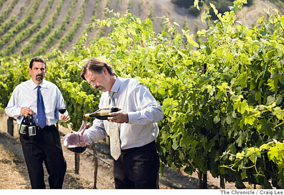 Robert Perkins (right) and John Lancaster (left), two wine sommeliers at Boulevard restaurant, make a wine together called Skylark. They are in the Rogers Creek area vineyard that produces their Syrah wine in Petaluma, Calif., on July 7, 2008.Photo by Craig Lee / SFC Photo: Craig Lee, The Chronicle