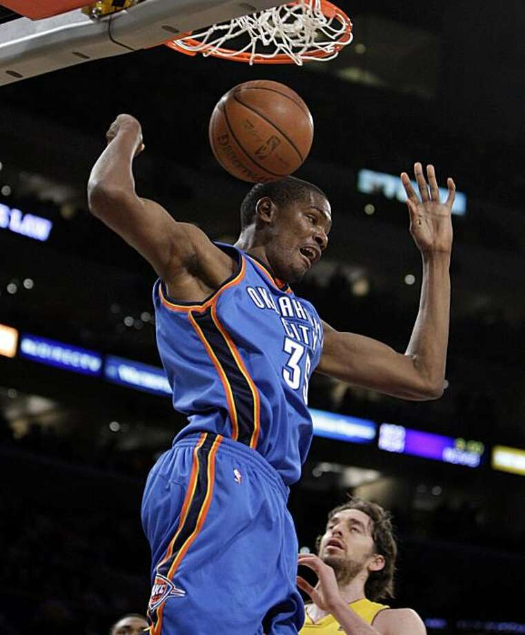 Oklahoma City Thunder's Kevin Durant dunks as Los Angeles Lakers' Pau Gasol, of Spain, bottom, looks on during the first half of their NBA basketball game in Los Angeles, Tuesday, Dec. 22, 2009. (AP Photo/Jae C. Hong) Photo: Jae C. Hong, AP