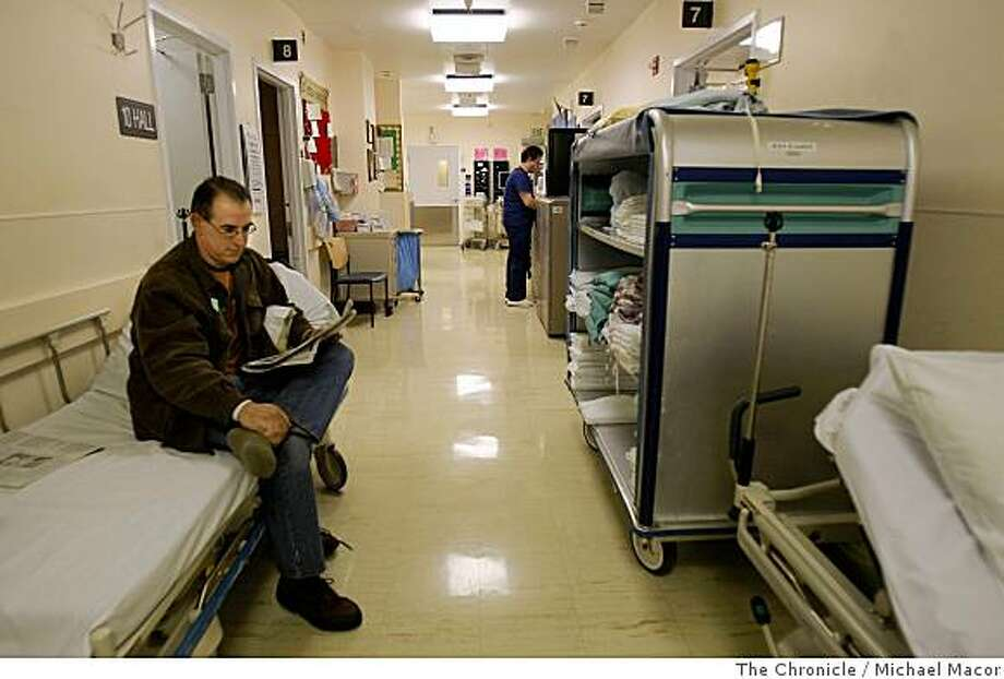 Chris Woodfall is treated for a foot injury in the hallway of the Emergency Department at Stanford Hospital in Palo Alto, Calif., on June 6, 2008. The emergency room staff uses the hallways to tend to patients due to a lack of hospital beds as well as injuries that are considered minor. Photo By Michael Macor/ The Chronicle Photo: Michael Macor, The Chronicle