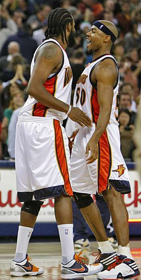 Golden State Warriors Ronny Turiaf and Corey Maggette beat their chests together to celebrate the defeat of the Boston Celtics,103-99,  Monday Dec. 28, 2009, at the Oracle Arena in Oakland, Calif. Photo: Lacy Atkins, The Chronicle