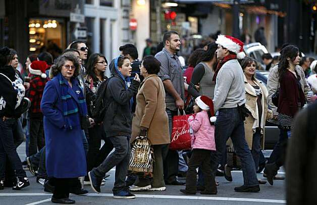 With only two days left before Christmas Day, shoppers scramble up Powell Street for last minute gifts, searching the stores around Union Square in San Francisco on Wednesday December 23, 2009. Photo: Michael Macor, The Chronicle