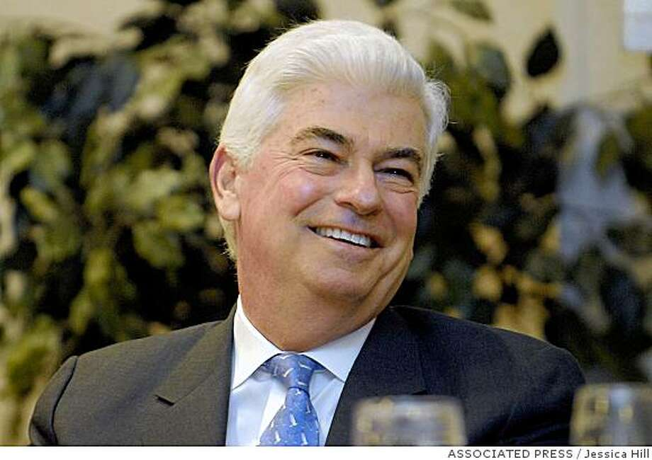 ** FILE ** In this Feb. 25, 2008 photo, Sen. Chris Dodd, D-Conn., smiles as he is introduced to members of the Middlesex County Chamber of Commerce  in Cromwell, Conn. If the veteran Senator's trademark jaunty smile seems a bit forced these days, it's no surprise. The five-term Democrat's home-state popularity has slipped in the wake of his failed presidential bid and allegations he got cut-rate mortgages from a leading offender in the subprime mortgage meltdown. (AP Photo/Jessica Hill, file) Photo: Jessica Hill, ASSOCIATED PRESS