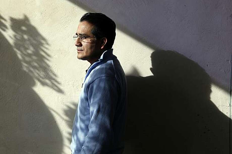 Julio Campos is a case manager for the non-profit Samaritan House which provides food, shelter, medical care and employment assistance to their clients. Campos at Samaritan House warehouse in San Mateo,Ca.  on Thursday December 24, 2009. Photo: Michael Macor, The Chronicle