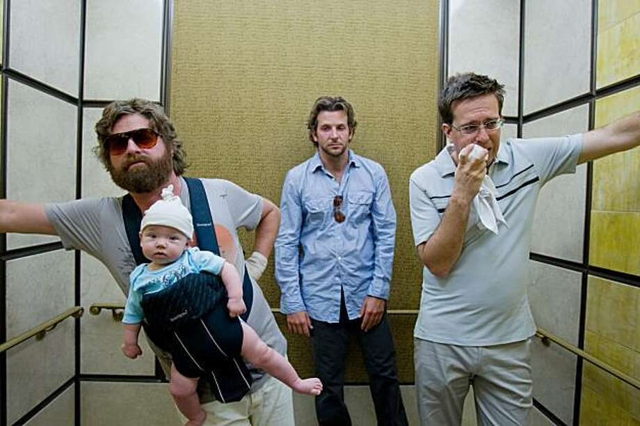 "FILE - In this film publicity image released by Warner Bros., Zach Galifianakis, left, Bradley Cooper, center, and Ed Helms are shown in a scene from ""The Hangover.""  The film was nominated Tuesday, Dec. 15, 2009 for a Golden Globe award for best motion picture comedy or musical. The awards will be held on Jan. 17, in Beverly Hills, Calif. (AP Photo/Warner Bros., Frank Masi, file) Photo: Frank Masi, AP"