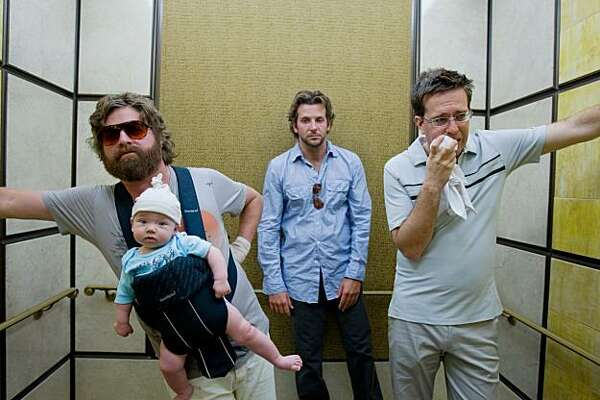 "FILE - In this film publicity image released by Warner Bros., Zach Galifianakis, left, Bradley Cooper, center, and Ed Helms are shown in a scene from ""The Hangover."" The film was nominated Tuesday, Dec. 15, 2009 for a Golden Globe award for best motion picture comedy or musical. The awards will be held on Jan. 17, in Beverly Hills, Calif. (AP Photo/Warner Bros., Frank Masi, file)"