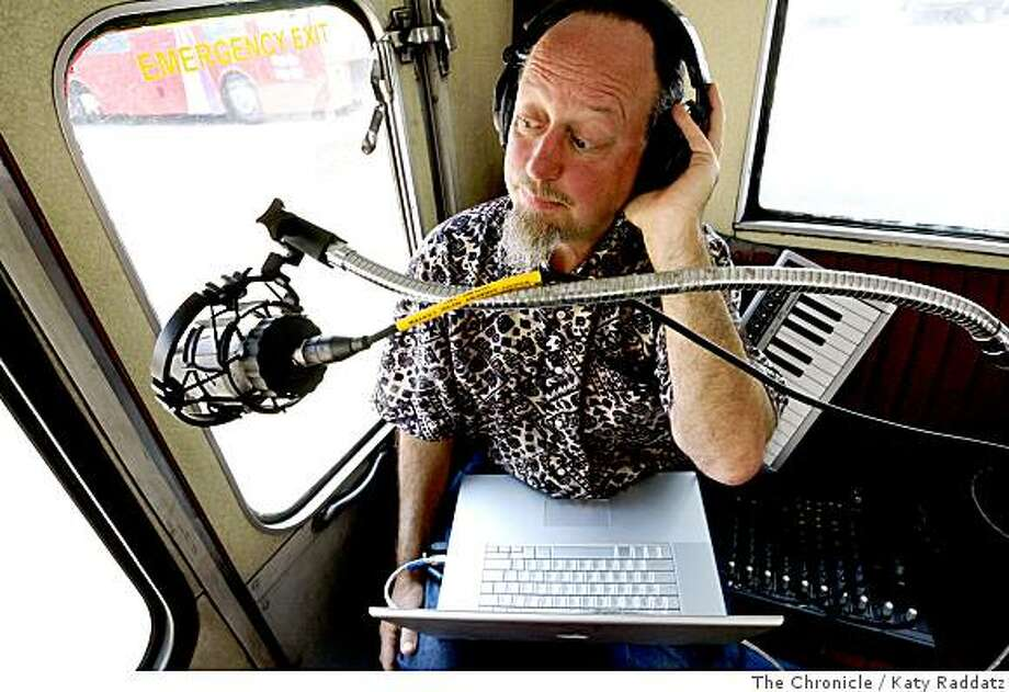 "Sound artist David Graves, with his sound collection and processing apparatus, demonstrates how he will perform ""Human Street Textures,"" a composition by himself and Ruidobello that is part of Project Soundwave series, in which a double decker bus takes people around San Francisco while a musician or sound artist performs, in San Francisco, Calif.  on Thursday,  July 3, 2008.Photo by Katy Raddatz / The Chronicle Photo: Katy Raddatz, The Chronicle"