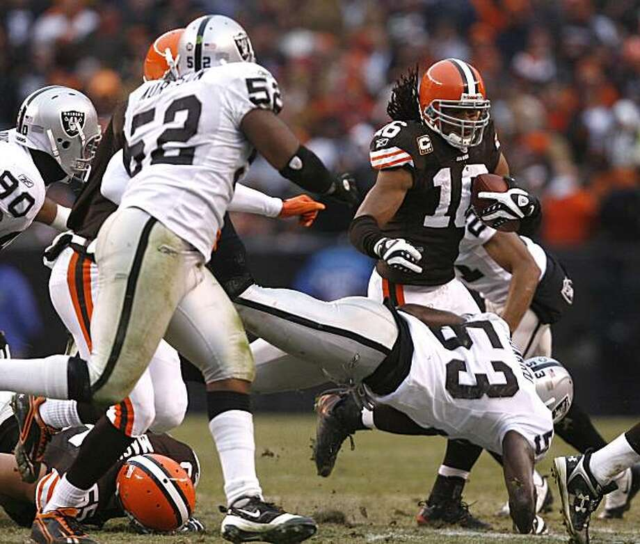 CLEVELAND - DECEMBER 27:  Joshua Cribbs #16 of the Cleveland Browns runs into Kirk Morrison #52 and Thomas Howard #53 of the Oakland Raiders at Cleveland Browns Stadium on December 27, 2009 in Cleveland, Ohio.  (Photo by Matt Sullivan/Getty Images) Photo: Matt Sullivan, Getty Images