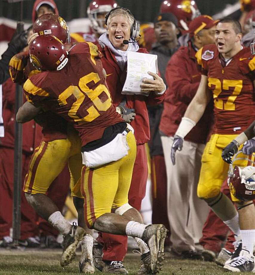 USC coach Pete Carroll smiles after an interception by Shareece Wright. Boston College vs. USC in the Emerald Bowl at AT&T Park in San Francisco on Saturday December  26th, 2009. Photo: John Storey, Special To The Chronicle