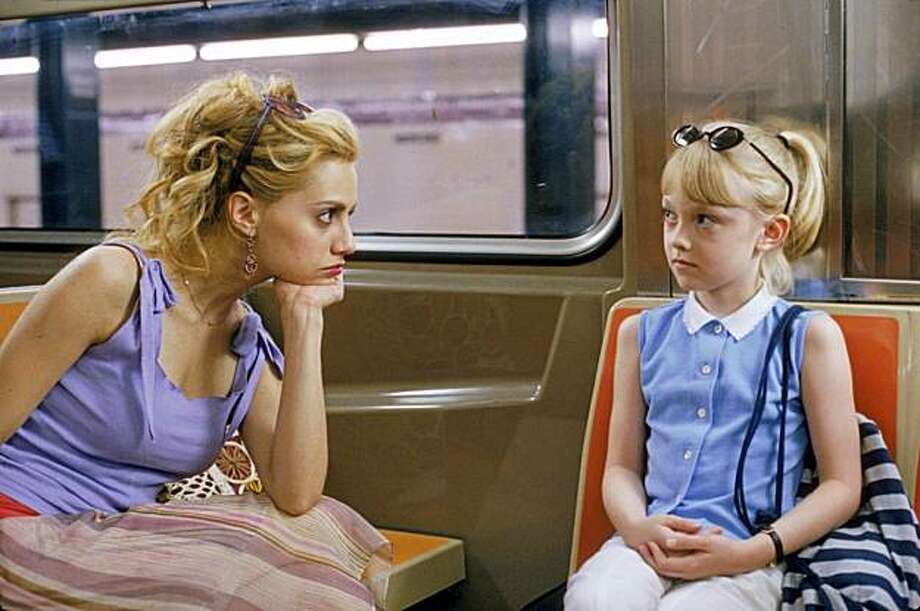 "Actresses Brittany Murphy (L) and nine-year-old Dakota Fanning, stars of the new comedy film ""Uptown Girls"", are shown in a scene from the film in this undated publicity photograph. Murphy stars as a nanny hired to look after a precocious young girl played by  Fanning, in the film which opens August 15 in the United States. NO SALES  REUTERS/MGM/Handout. Also ran 8/21/03 Photo: MGM, Reuters"