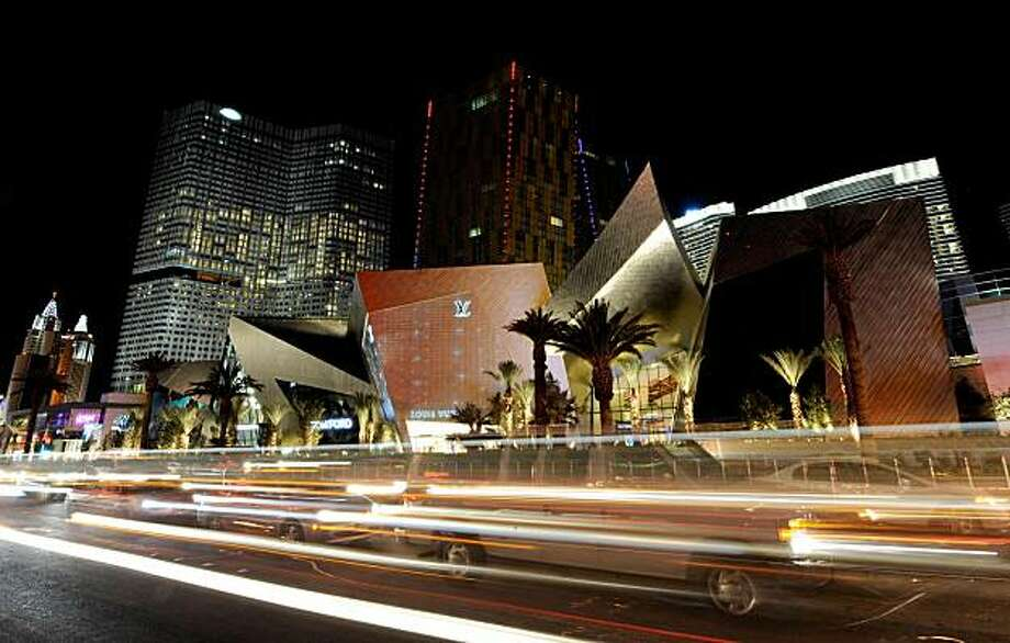 LAS VEGAS - DECEMBER 08:  A general view of CityCenter including Crystals (front), the project's retail and entertainment district, December 8, 2009 in Las Vegas, Nevada. The 67-acre, USD 8.5 billion mixed-use urban development center, a joint project between MGM Mirage and Dubai World, is said to be the biggest privately financed construction project in United States history and one of the world's largest green projects being built with the Leadership in Energy & Environmental Design (LEED) Gold certified Green Building Rating System. CityCenter's centerpiece, the Aria Resort & Casino, opens on December 16, 2009.  (Photo by Ethan Miller/Getty Images for CityCenter) Photo: Ethan Miller, Getty Images For CityCenter