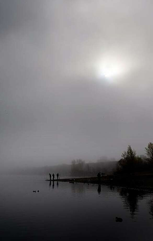 Fisherman along the shores of Shadow Cliffs Regional Park, in Pleasanton, Calif., on Thursday Nov. 13, 2008.  With the lake being stocked with 2,000 pounds of fish this week, anglers were catching fish one after another as the morning fog began to break up. Photo: Michael Macor, The Chronicle