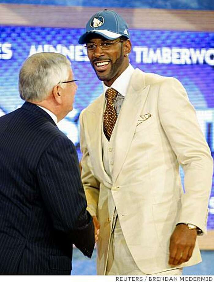 OJ Mayo shakes hands with NBA Commissioner David Stern after being selected as the third overall pick by the Minnesota Timberwolves in the 2008 NBA Draft at Madison Square Garden in New York, June 26, 2008.     REUTERS/Brendan McDermid (UNITED STATES) Photo: BRENDAN MCDERMID, REUTERS