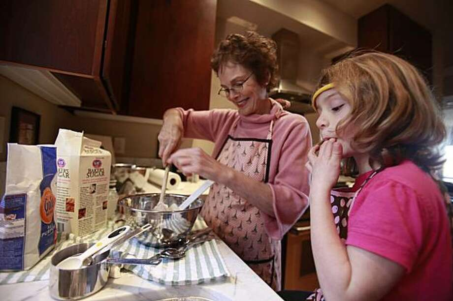 Dietician JoAnn Hattner (l to r) and her granddaughter Isabella Ballon, 6, mix ingredients to make sugar cookies using Ballon's great grandmother's recipe in San Francisco, Calif. on Wednesday December 23, 2009. Photo: Lea Suzuki, The Chronicle