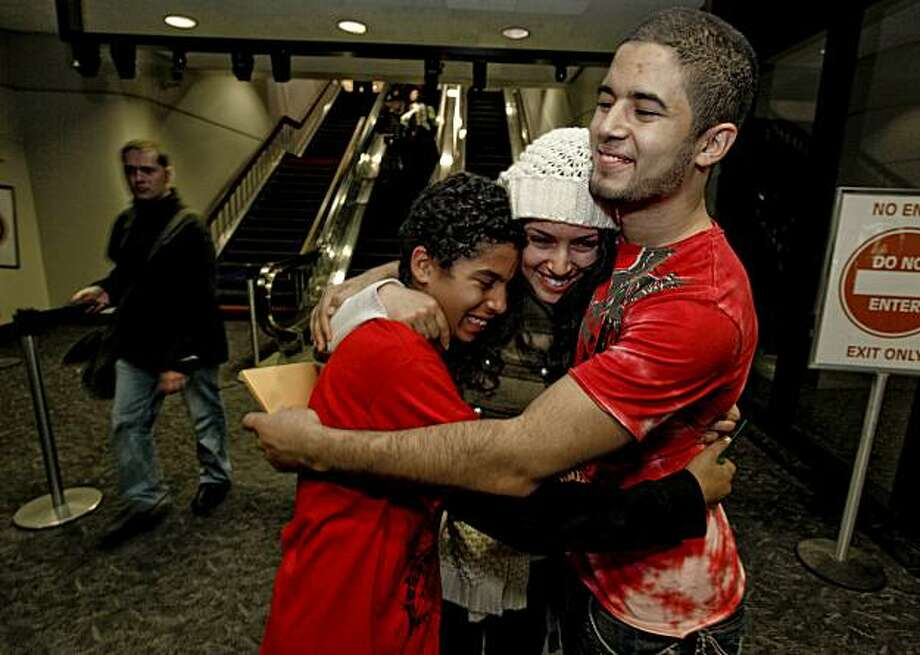 21 year old Ikram Mansori, arrives at San Francisco International Airport on Friday December 18, 2009, and is greeted by her two brothers Hatim, (left)  and Abdul. She is on a two week leave from the Army where she is an interpreter based in Iraq. Photo: Michael Macor, The Chronicle