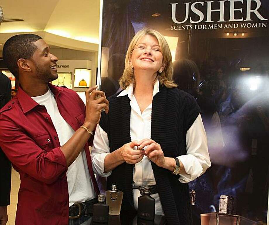 """FILE-This Sept. 10, 2007 file photo  released by """"The Martha Stewart Show,"""" R&B artist, Usher, sprays Martha with his  fragrance, 'Usher She,' at a Macy's in New York City. (AP Photo/The Martha Stewart Show, Anders Krusberg,File) **NO SALES Photo: Anders Krusberg, AP"""