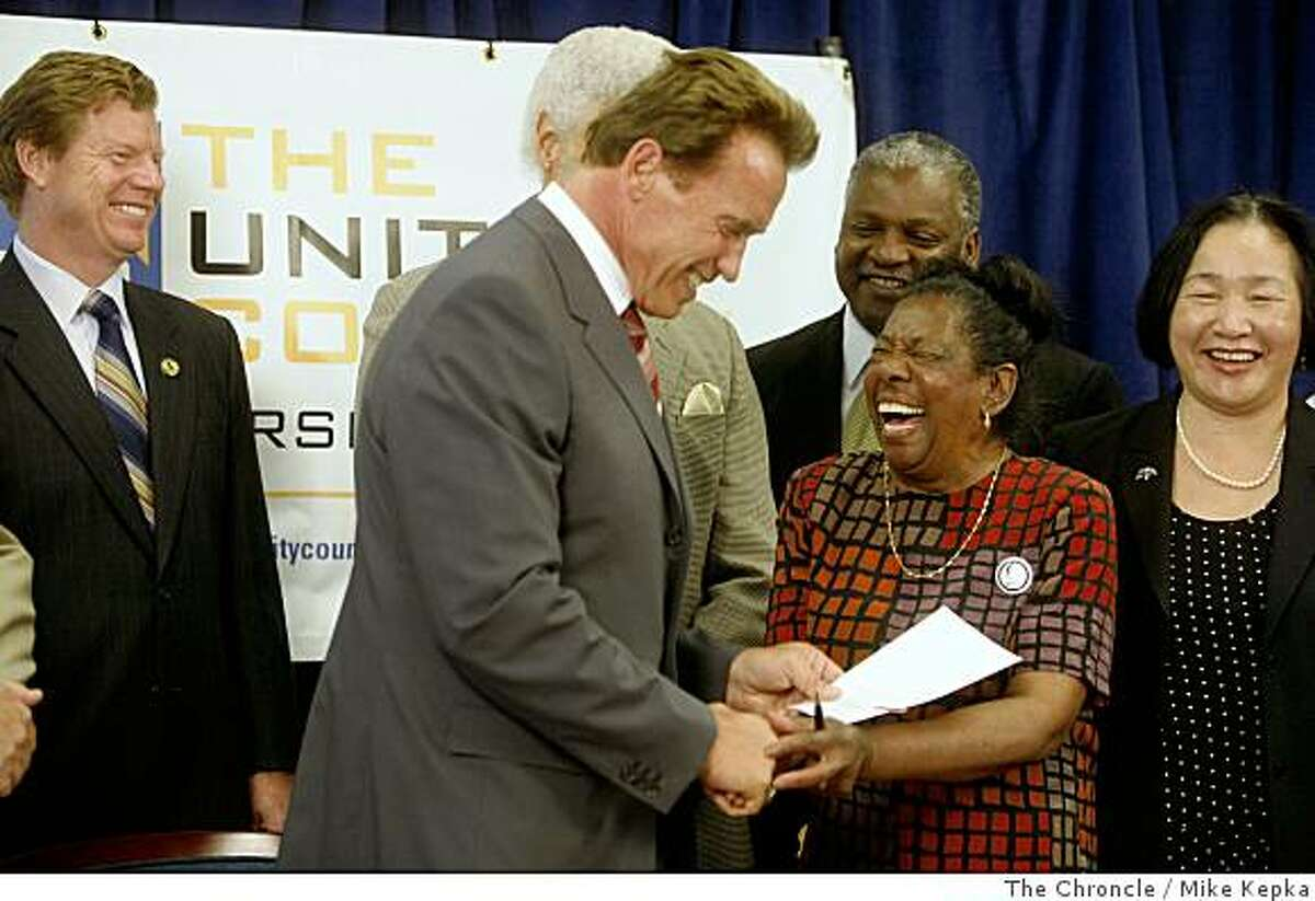 After Governor Arnold Schwarzenegger signed a foreclosure bill called SB1137, her greats Dorothy Hicks of Oakland r at The Unity Council building on Tuesday July 8, 2008 in Oakland, Calif. Hicks who's home was in foreclosure over a year ago pleaded her case in front of the state senate in Sacramento which kick started Perata's foreclosure bill.Photo by Mike Kepka / The Chronicle