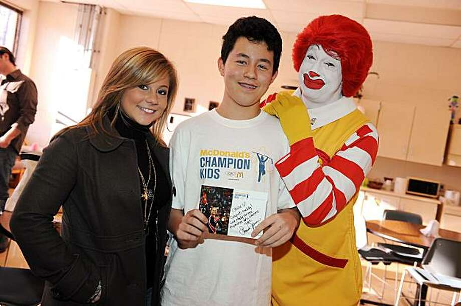 ** COMMERCIAL IMAGE ** In this image released by PictureGroup, olympic gold medalist Shawn Johnson, left, and Ronald McDonald surprise McDonald's Champion Kid essay winner Chisu Edwards with a trip to the 2010 Olympic Games at Frelinghuysen Middle School on Wednesday, Dec. 16, 2009, in Morristown, N.J.  (Photo by Scott Gries/PictureGroup for McDonalds) Photo: Scott Gries, PictureGroup