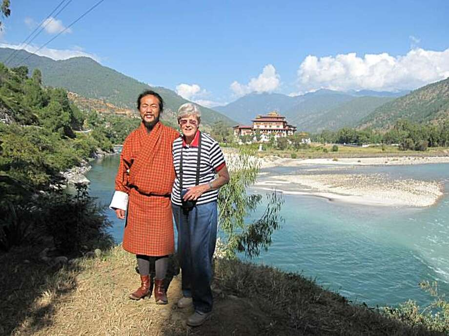 Elisabeth Levy with Bhutanese guide Palden in front of the Punakha Dzong. Photo: Courtesy Of Elisabeth Levy