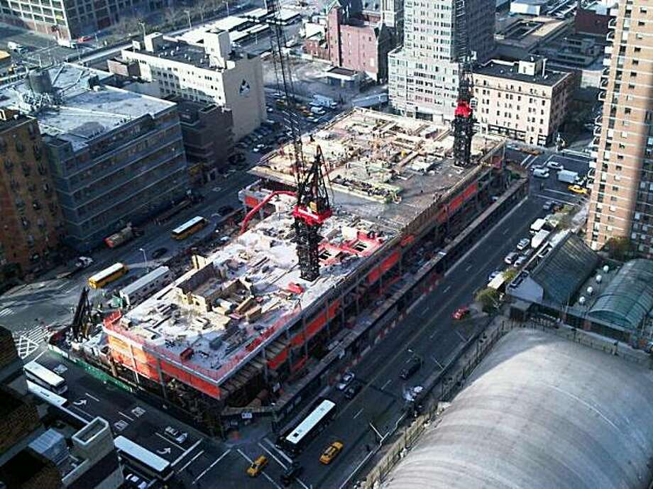 In this undated photo released by Signature Theater Company via New York City Hall, the construction site of the new Signature Theater in New York City is shown. The facility, designed by famed architect Frank Gehry, will include three theaters, rehearsal studios, a cafe and a bookstore. (AP Photo/Signature Theater Company) **NO SALES** Photo: AP
