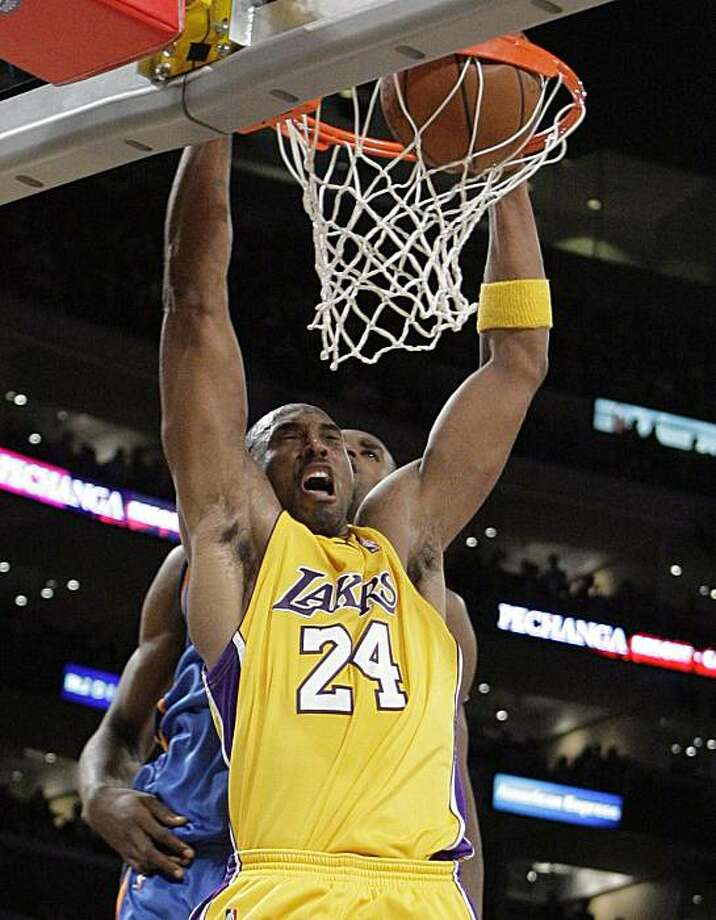 Los Angeles Lakers' Kobe Bryant dunks against Oklahoma City Thunder's Serge Ibaka during the second half of their NBA basketball game in Los Angeles,  Tuesday, Dec. 22, 2009. The Lakers won 111-108. (AP Photo/Jae C. Hong) Photo: Jae C. Hong, AP