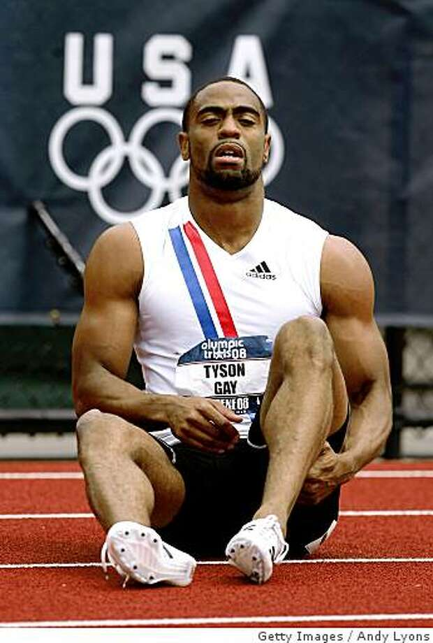 EUGENE, OR - JULY 05:  Tyson Gay holds his leg after falling to the track in pain at the back turn of the men's 200 meter quarter-finals during day seven of the U.S. Track and Field Olympic Trials at Hayward Field on July 5, 2008 in Eugene, Oregon.  (Photo by Andy Lyons/Getty Images) Photo: Getty Images