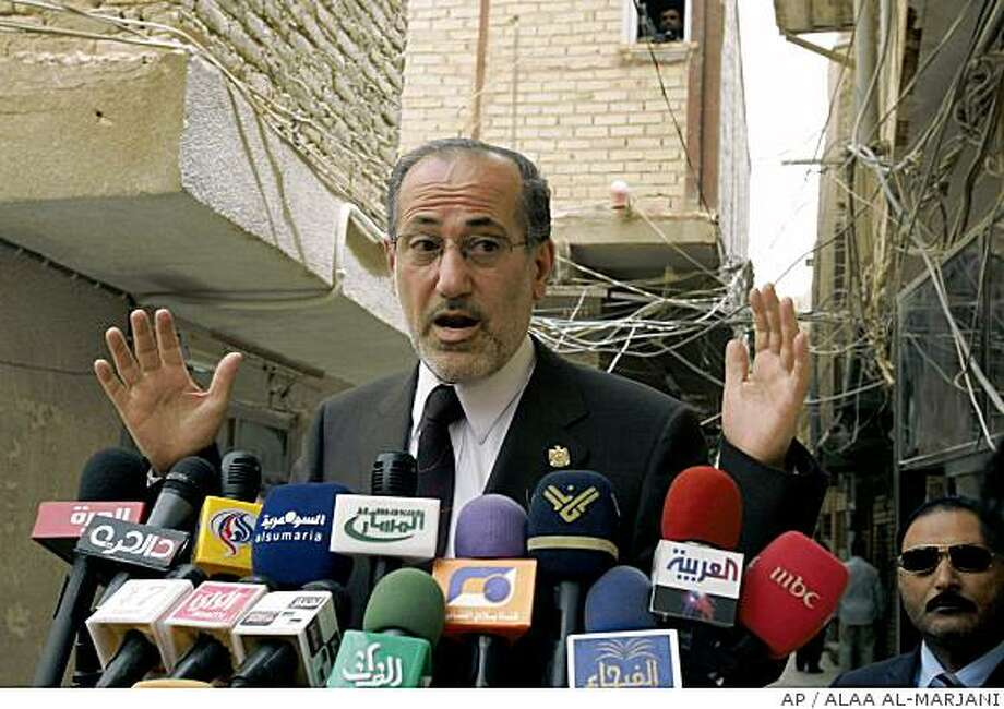 Iraq's national security adviser, Mouwaffak al-Rubaie, gestures as he speaks to reporters in Najaf, 160 kilometers (100 miles) south of Baghdad, Iraq, Tuesday, July 8, 2008. Al-Rubaie said Tuesday his country will not accept any security deal with the United States unless it contains specific dates for the withdrawal of U.S.-led forces. (AP Photo/Alaa al-Marjani) Photo: ALAA AL-MARJANI, AP