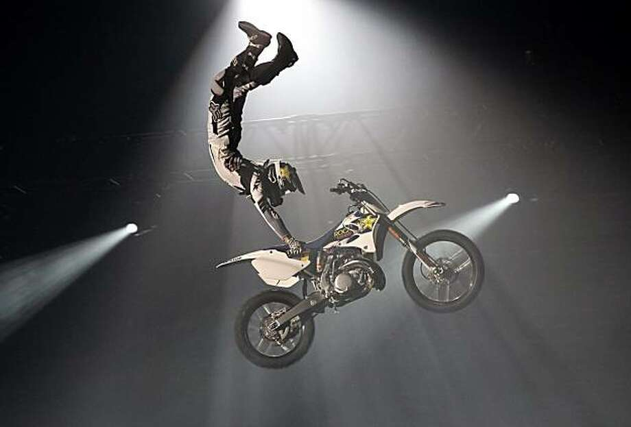 In this Dec. 15, 2009 photo released by Feld Motor Sports, Mike Mason, of Reno, Nev., performs a Hart Attack at the Los Angeles Arena in Los Angeles.  (AP Photo/Feld Motor Sports, Jake Klingensmith) Photo: Jake Klingensmith, AP
