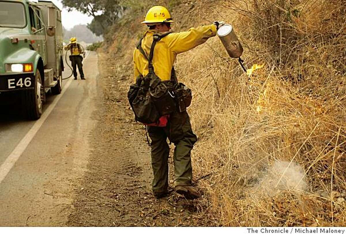 US Forest Service firefighter Salty Hoffman of Santa Barbara creates a back fire east of Highway 1 near Big Sur, Calif. on July 6, 2008. Nearly 2,000 firefighters try to beat back the out-of-control Basin Complex wildfire near the coastal tourist town of Big Sur.Photo by Michael Maloney / The Chronicle