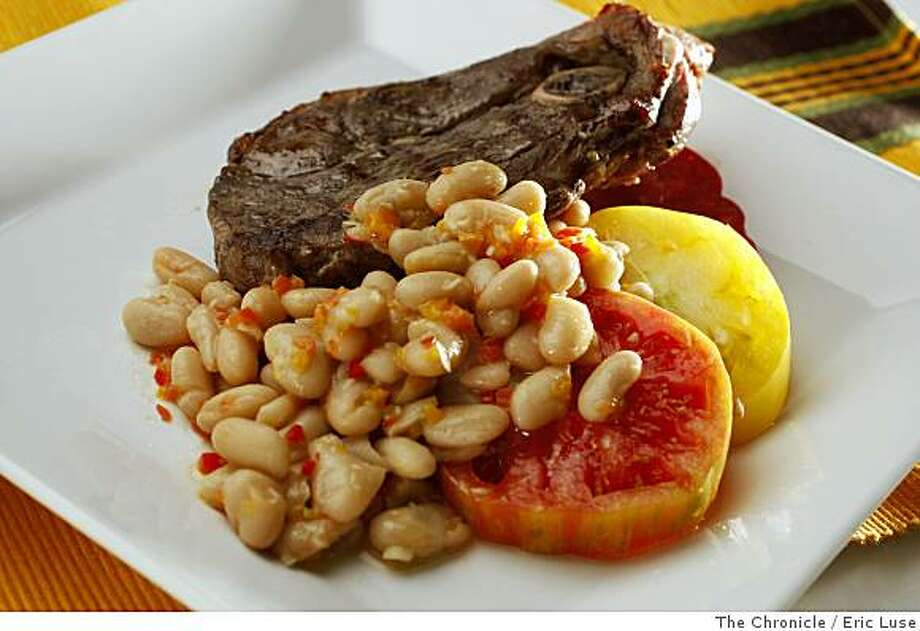 Working Cook Lamb Steaks with White Bean Salad with heirloom tomatoes with salt and olive oil Photo: Eric Luse, The Chronicle