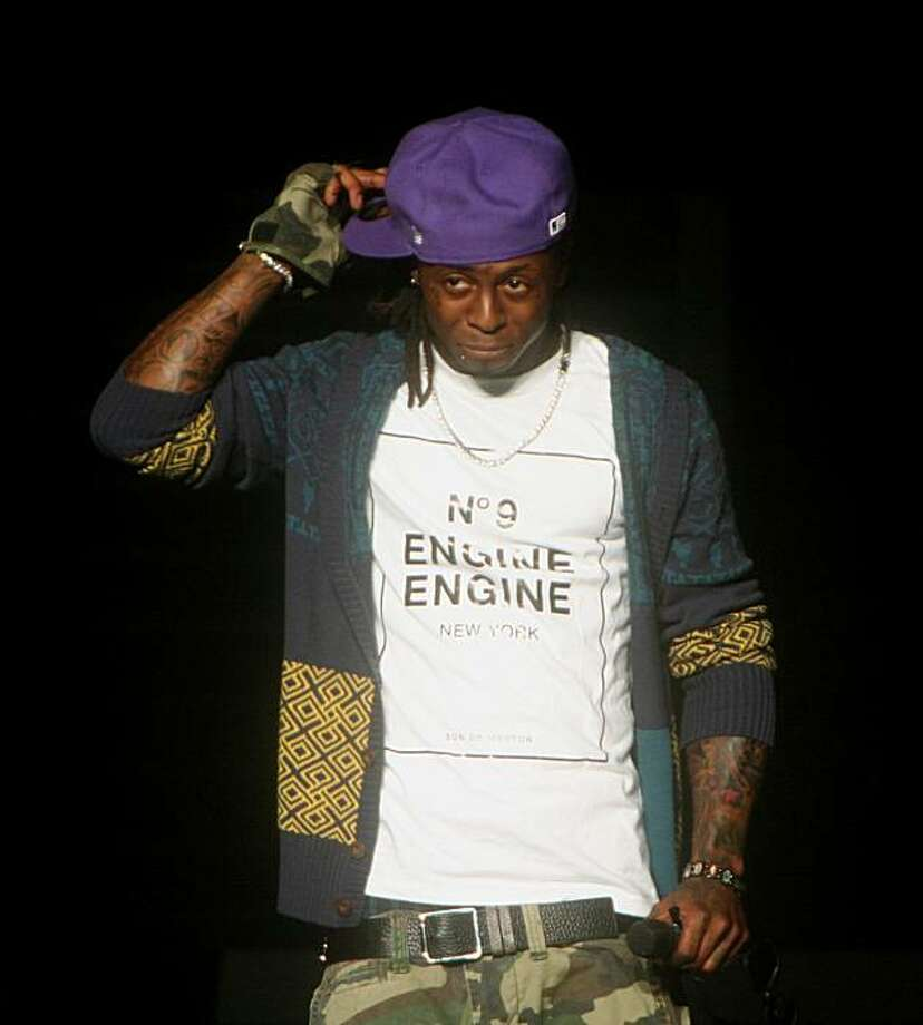 "**FILE PHOTO** Lil Wayne performing in August 2009 at Jones Beach in Wantagh, N.Y. His crew, Young Money, released its debut album, ""We Are Young Money"" on Tuesday. (Hiroyuki Ito/The New York Times) Photo: Hiroyuki Ito, NYT"