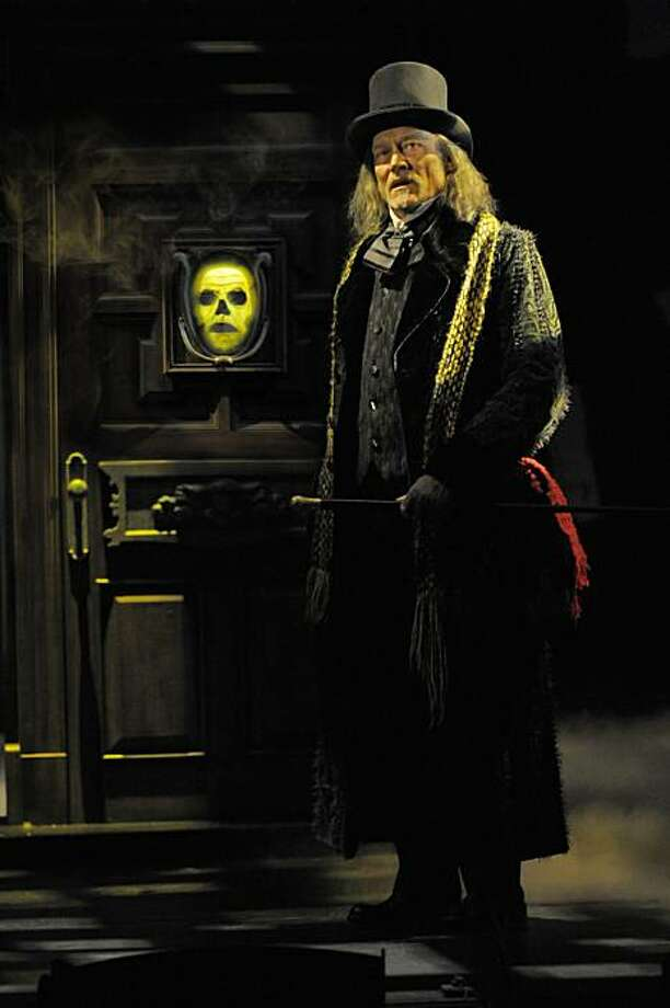 "Ebenezer Scrooge (James Carpenter) gets an unexpected shock when he approaches his own front door in ACT's ""A Christmas Carol"" Photo: Kevin Berne"