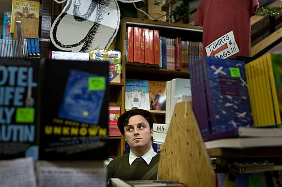 Local blogger and guidebook author Stuart Schuffman, better known as BrokeAss Stuart, hunts for cheap book deals at Green Apple on Clement Streeet while Christmas shopping in San Francisco, Calif. on Monday, Dec. 14, 2009. Photo: Adam Lau, The Chronicle