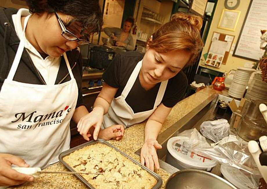 "Yamileth Alfaro (12) 7th grader, just baked a moca cram cake  with a help of a baker Felicia Sanchez (right) who mentors Yamileth every monday at the 'Mama's on Washington Square"" bakery. Monday, November 30, 2009. San Francisco Calif. Photo: Jana Asenbrennerova, The Chronicle"