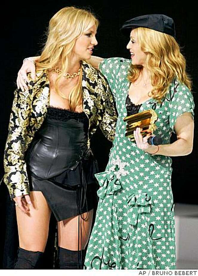 ** FILE ** In this Jan. 24, 2004 file photo,  Britney Spears, left, gives an award to U.S. singer Madonna, right, during the NRJ awards ceremony in Cannes, France. (AP Photo/Bruno Bebert, file) Photo: BRUNO BEBERT, AP